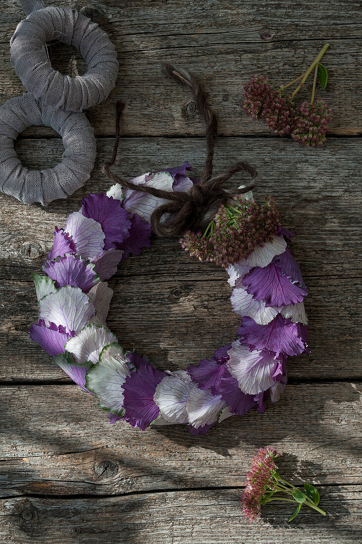 Wreath of white and purple ornamental cabbage leaves and sedums