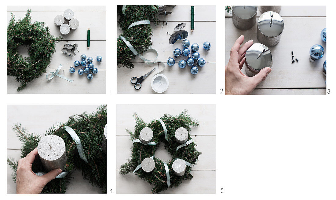 Decorating an Advent wreath with silver candles and blue Christmas-tree baubles