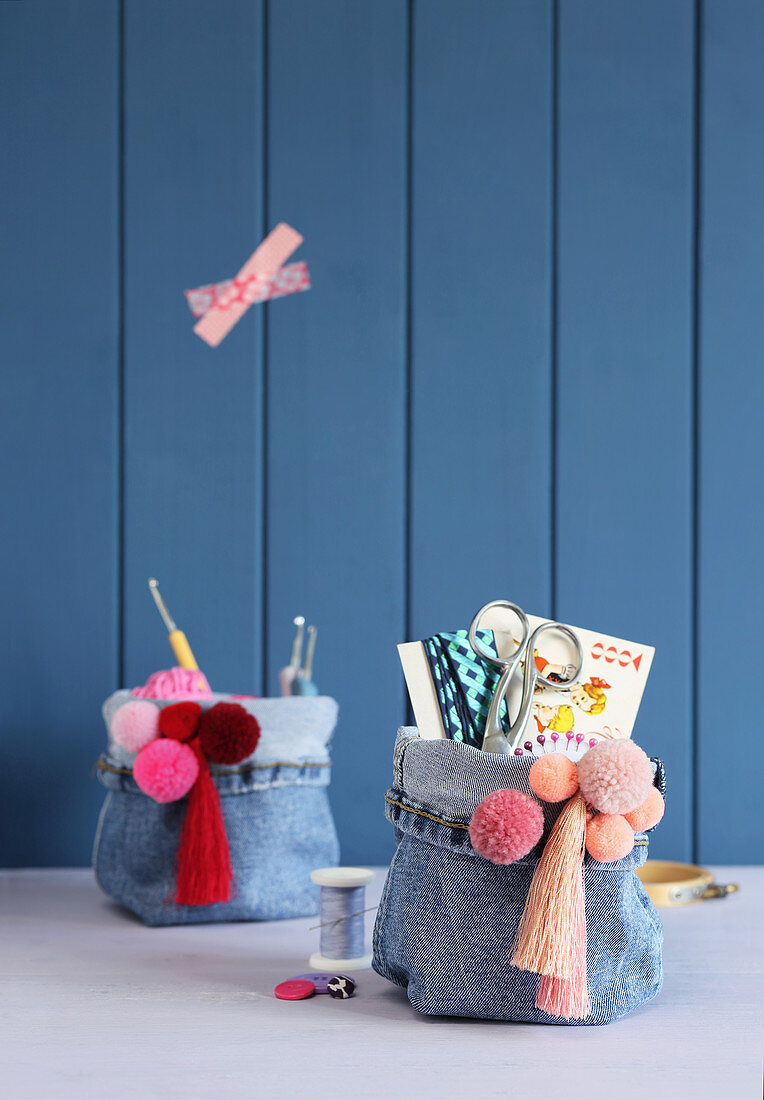 Handmade denim organisers decorated with pompoms and fringes