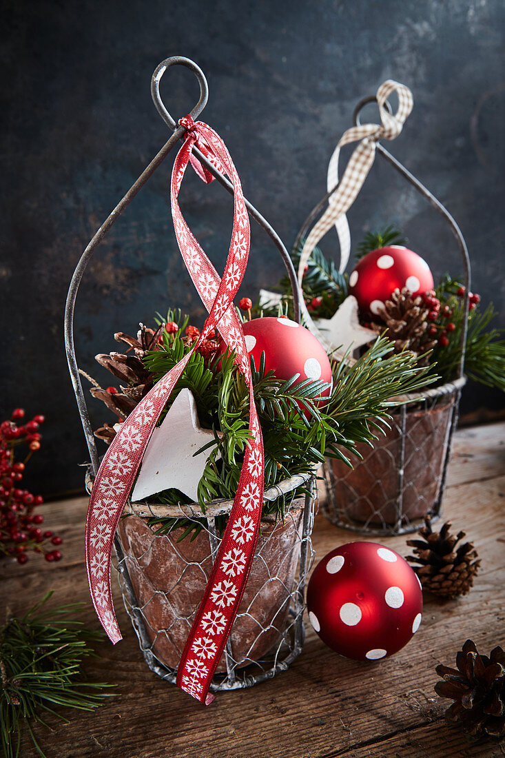 Festive arrangements of fir branches and polka-dot baubles