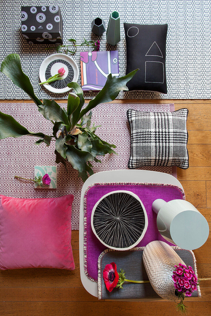 Moodboard of patterned accessories in grey and pink