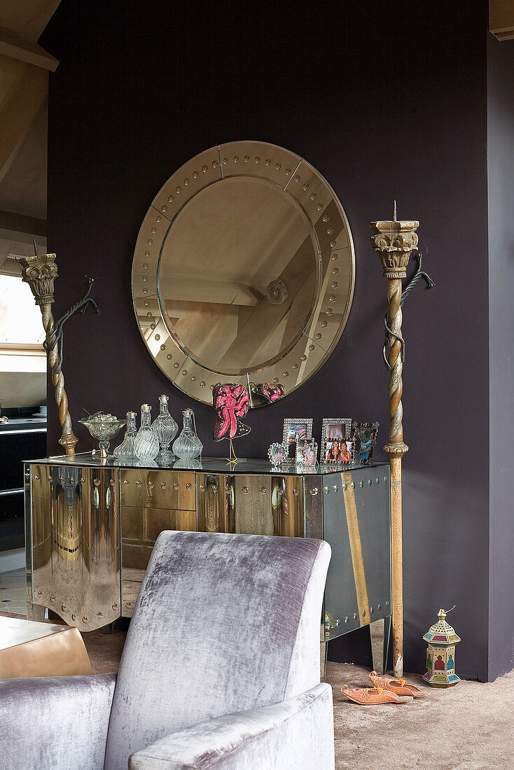 Ornaments on mirrored sideboard