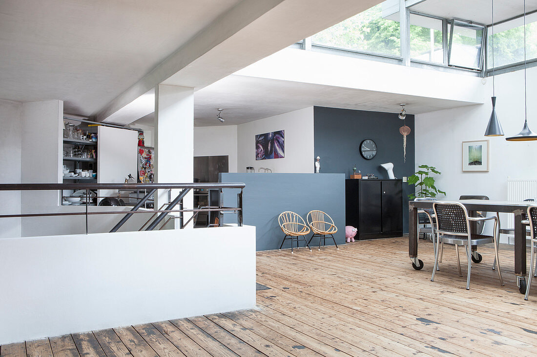 A view of a dining area in a loft apartment with wooden floorboards