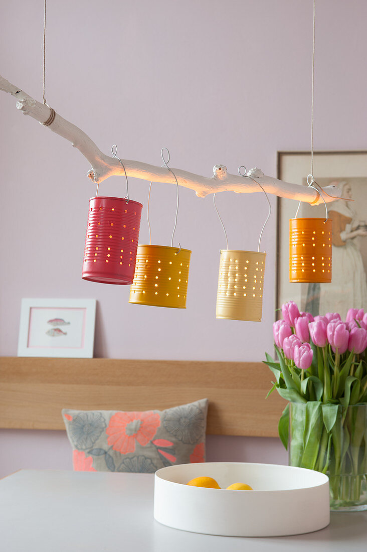 Handmade lamp made from branch and painted tin cans