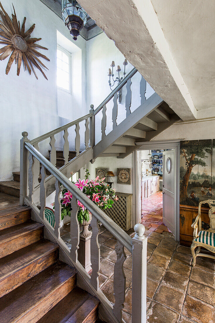 Staircase and hallway with garden access