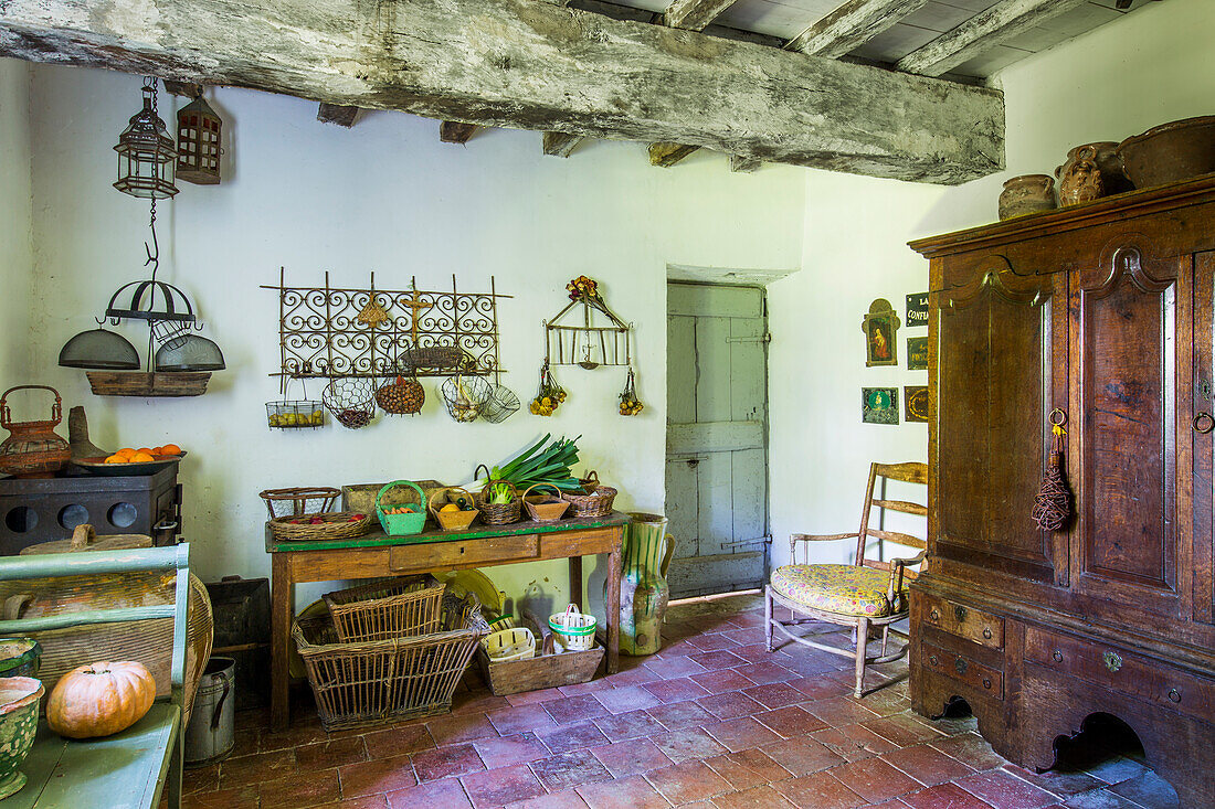 Antique wooden cupboard, shelves and table in the pantry