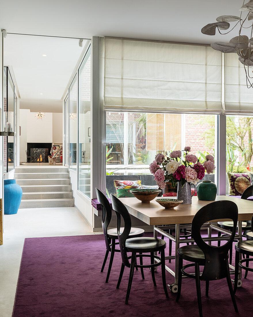 Spacious split-level dining area with large sliding windows