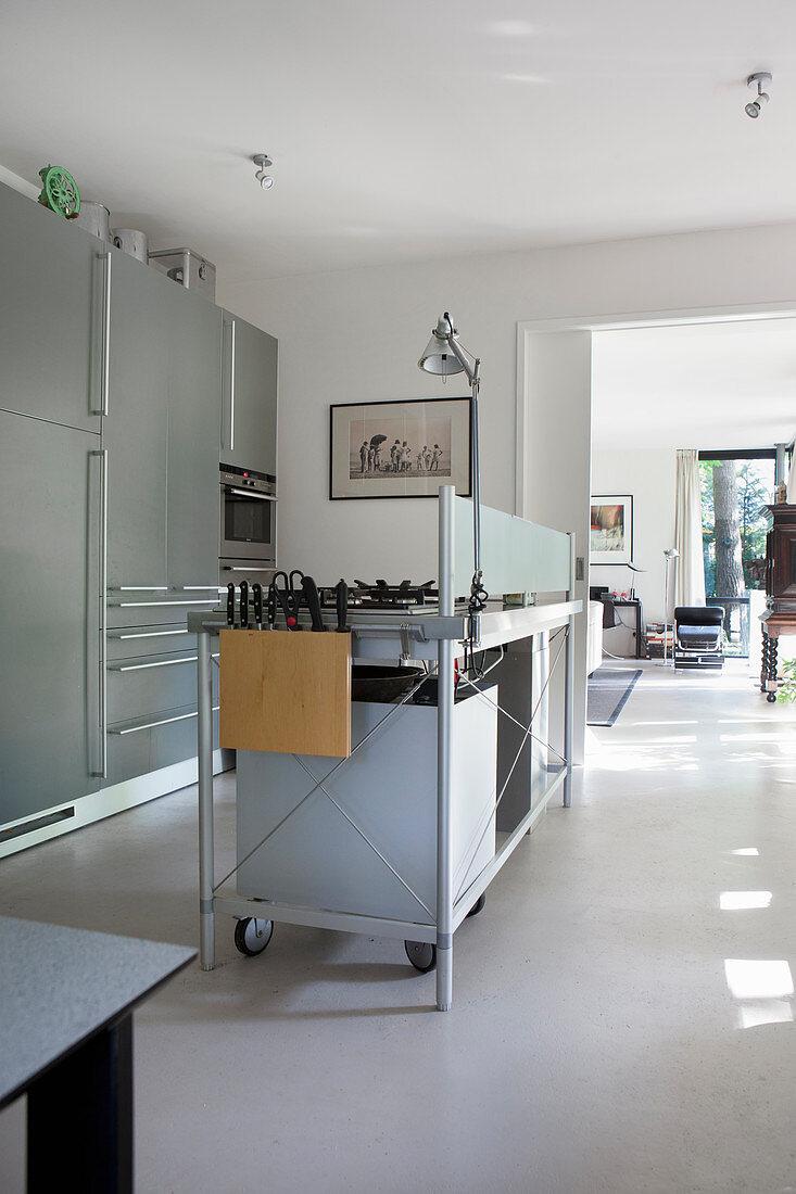 Industrial-style island counter in modern masculine kitchen