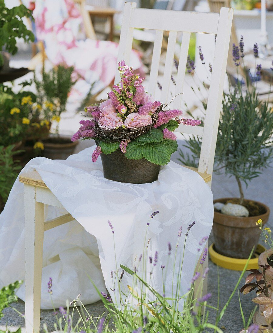 Flower arrangement on a chair in the open air