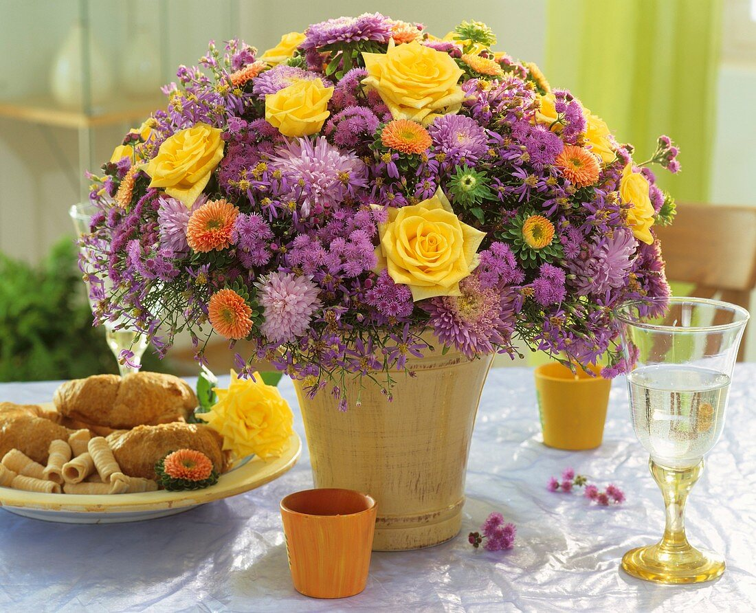 Arrangement of roses, chrysanthemums and asters