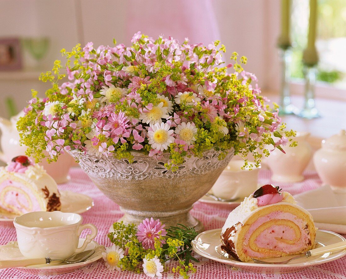 Table laid for coffee with  marguerites & lady's mantle