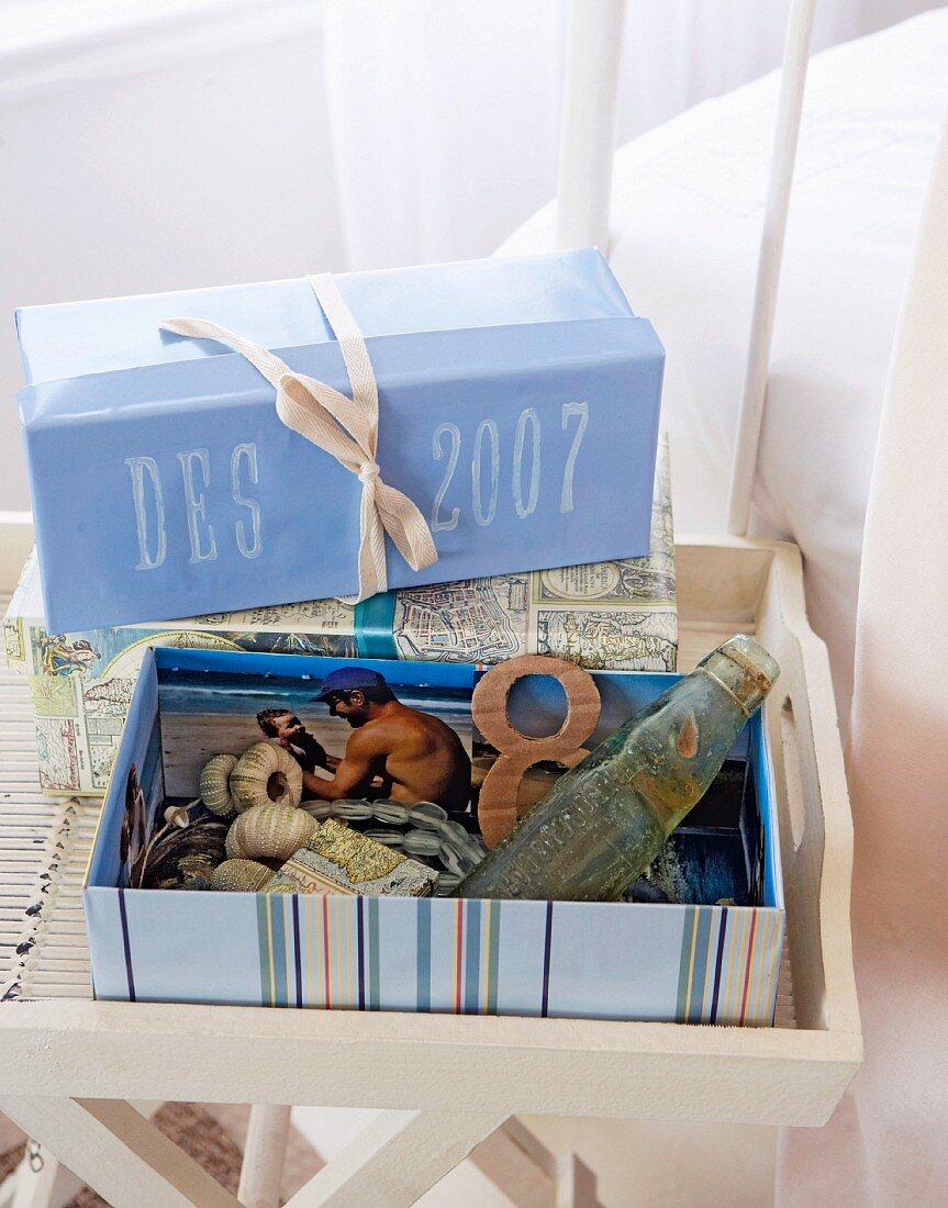 Cardboard box containing maritime items