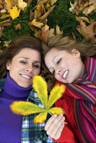 Mother and daughter with autumn leaf