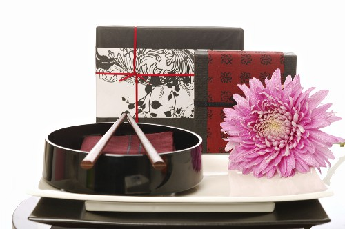 Arrangement of Asian tableware and gifts