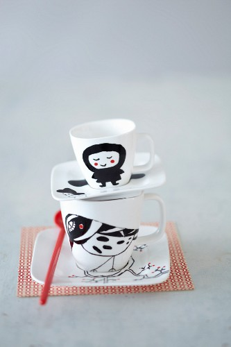 A hand-painted coffee and espresso cup
