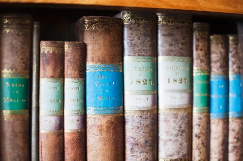 The library at Corvey – antique books with gold decorations on a bookshelf