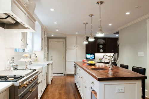 Spacious country-house kitchen with island and walnut worksurface