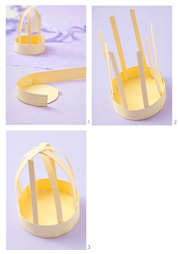 A bird cage being crafted from paper