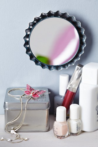 Tart tin upcycled into mirror
