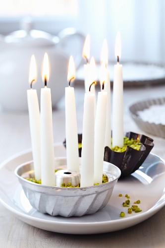Small cake moulds used as candle holders