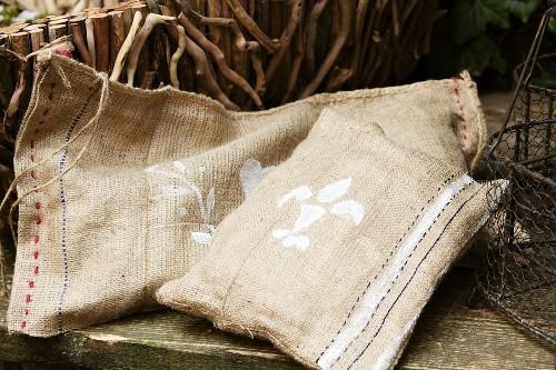 Hand-sewn hessian cushions on rustic garden bench