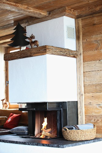 Modern fireplace with sliding door in rustic wooden house