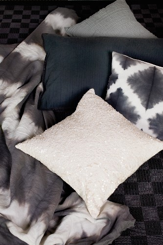 Scatter cushion with sequins, black and white cushions and batik-look blanket