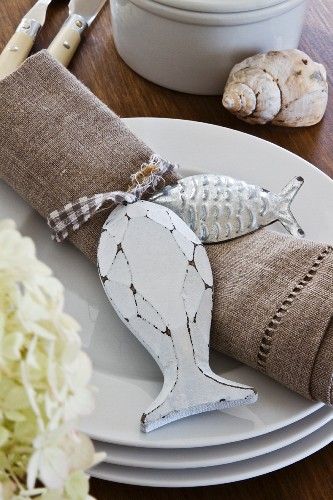 Linen napkin with accessories on stack of plates