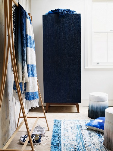 Blue hall cupboard and wooden coat rack