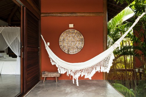 Hammock and view into bedroom of beach house