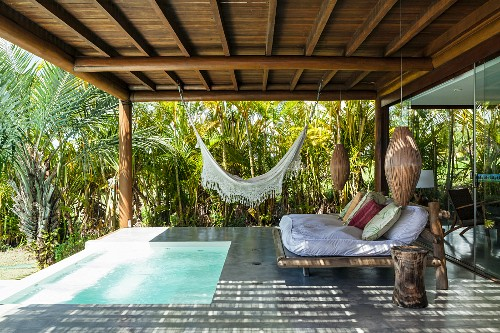 Roofed relaxation area with small pool