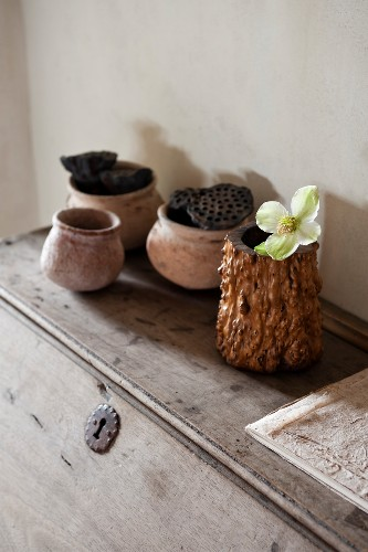 Wood and ceramic pots on rustic writing desk