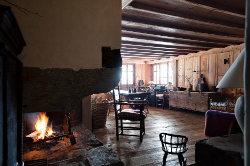 Open fireplace in rustic cabin interior