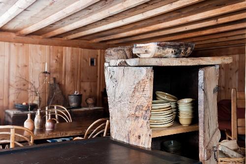 Rustic wooden cupboard in wooden cabin