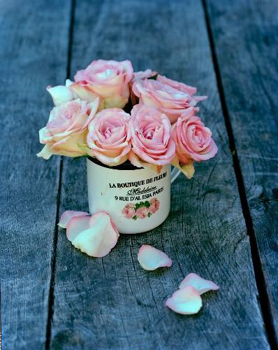 Posy of roses in romantic metal mug