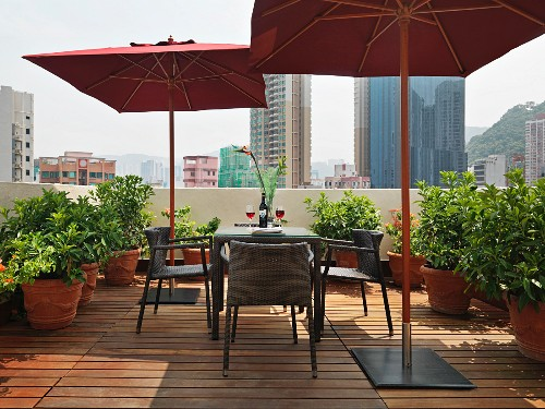 Dining table and parasols on wooden patio