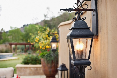Close-up of a lit lantern mounted on wall; Rancho Sante Fe; USA