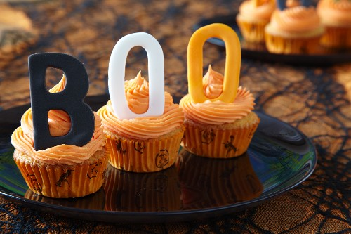 Halloween cupcakes decorated with buttercream icing and decorative letters