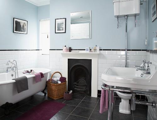 Bathroom with tiled dado, open fireplace and retro bathtub