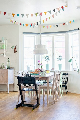 Bunting above dining area in bay window of kitchen-dining room