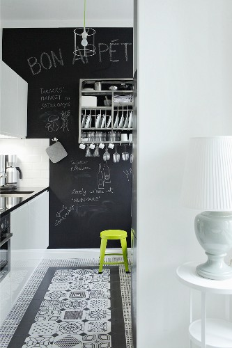 Kitchen with decorative black and white floor tiles and chalkboard wall