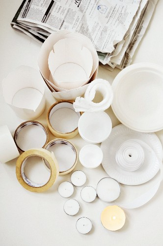 Painting and crafting materials: take-away cartons, tealights, masking tape, newspaper and paper plates