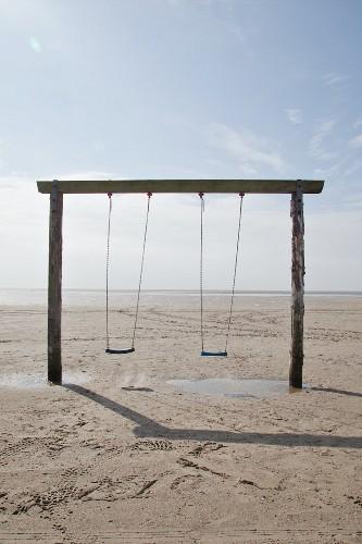 Simple set of swings on beach