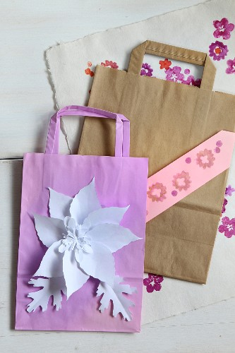 Creative crafting with paper: paper bags with glued and stamped decorations