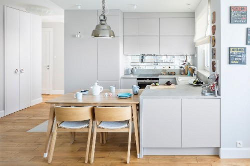 Bright, open-plan fitted kitchen with integrated dining area