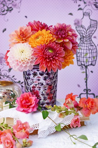 Bouquet of dahlias in silvered glass vase