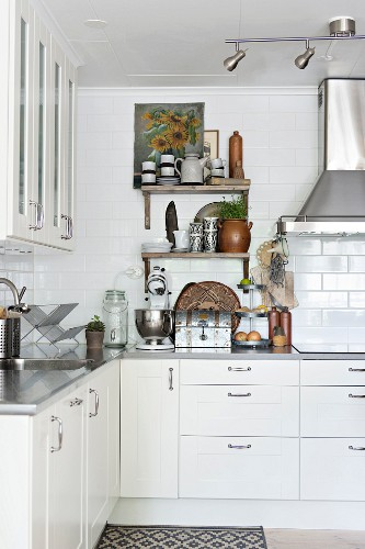 L-shaped fitted kitchen with white-painted cabinets