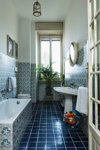 Bathroom With Dark Blue Floor Tiles