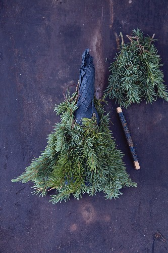 A bottle of wine wrapped in pine sprigs