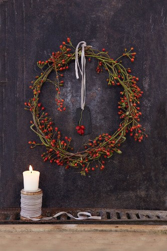 A homemade autumnal rose-hip wreath